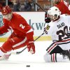Photo - Chicago Blackhawks left wing Brandon Saad (20) loses the puck to Detroit Red Wings defenseman Brendan Smith (2) in the first period of an NHL hockey game Wednesday, Jan. 22, 2014, in Detroit. (AP Photo/Paul Sancya)