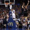 Oklahoma City Thunder\'s Russell Westbrook (0) floats to the basket between Portland Trail Blazers\' Luke Babbitt (8) and Meyers Leonard (11) as the Oklahoma City Thunder defeat the Portland Trail Blazers 106-92 in NBA basketball at the Chesapeake Energy Arena in Oklahoma City, on Friday, Nov. 2, 2012. Photo by Steve Sisney, The Oklahoman