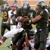 Midwest City\'s James Flanders, left, scores a touchdown beside Myles Hogg as Del City\'s Quintrell Boykins tries to bring him down during a high school football game in Midwest City, Okla., Friday, September 3, 2010. Photo by Bryan Terry, The Oklahoman