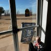 A resident sits in the sunlight poring through a glass door in the gymnasium/multi-purpose room at the 54-bed facility, Center of Family Love, a group home for mentally disabled people, in Okarche on Monday, Jan. 18, 2010. Photo by Jim Beckel, The Oklahoman