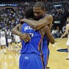 Oklahoma City\'s Reggie Jackson (15) celebrates with Kevin Durant (35) after Game 4 in the first round of the NBA playoffs between the Oklahoma City Thunder and the Memphis Grizzlies at FedExForum in Memphis, Tenn., Saturday, April 26, 2014. Photo by Bryan Terry, The Oklahoman