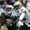 "Photo - FILE - In this Dec. 22, 2013 file photo, Carolina Panthers' Steve Smith, left, catches a pass as New Orleans Saints' Keenan Lewis, right, defends in the first half of an NFL football game in Charlotte, N.C.The agent for  Smith says the five-time Pro Bowl selection has played his final snap for the Panthers. Smith's longtime representative Derrick Fox told The Associated Press on Wednesday, March 12, 2014,  that Smith ""is not going to play for the Panthers next year, I know that. I just don't know when that transaction is going to take place."" (AP Photo/Chuck Burton, File)"