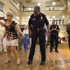 Bonnie Rasmussen (left) teaches new Norman police chief Keith L. Humphrey a line dance at Rivermont Retirement Community during the National Night Out on Tuesday, August 2, 2011, in Norman, Okla. Photo by Steve Sisney, The Oklahoman