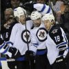 Winnipeg Jets\' defenseman Ron Hainsey (6), left winger Andrew Ladd (16) and center Brian Little (18) celebrate a goal by Ladd during the second period of an NHL hockey game against the Buffalo Sabres in Buffalo, N.Y., Tuesday, Feb. 19, 2013. (AP Photo/Gary Wiepert)