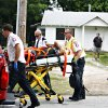 A person reportedly injured by Anthony Giancola is wheeled to a waiting ambulance, in Lealman, Fla., Friday, June 22, 2012. Authorities said Giancola, an ex-Tampa Bay-area middle school principal who lost his job over a drug arrest five years ago, went on a rampage Friday, stabbing several people, killing at least two. Authorities said there were 11 victims in all, and several are being treated at area hospitals for injuries ranging from minor to life-threatening. (AP Photo/Tampa Bay Times, Melissa Lyttle) TAMPA OUT; CITRUS COUNTY OUT; PORT CHARLOTTE OUT; BROOKSVILLE HERNANDO TODAY OUT