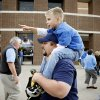 Ryan Weeres of Okarche carries his son Landon Weeres, 6, outside the Oklahoma CIty Arena before the NBA basketball game between the Denver Nuggets and the Oklahoma City Thunder in the first round of the NBA playoffs at the Oklahoma City Arena, Wednesday, April 27, 2011. Photo by Bryan Terry, The Oklahoman