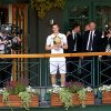 Britain\'s Andy Murray stands on the balcony of Centre Court with the tropjy after winning the Men\'s singles title on during day thirteen of the Wimbledon Championships at The All England Lawn Tennis and Croquet Club, Wimbledon, London, Sunday July 7, 2013. (AP Photo/Dominic Lipinski, PA) UNITED KINGDOM OUT