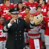 Photo - In this Sept. 7, 2013 photo, Ohio State University marching band director Jon Waters leads the band in