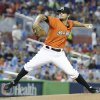 Photo - Miami Marlins' Brad Hand delivers a pitch during the first inning of a baseball game against the San Francisco Giants, Sunday, July 20, 2014 in Miami. (AP Photo/Wilfredo Lee)