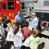 Norman firemen talk about a fire-rescue rig and equipment as fifth-graders from Madison Elementary School in Norman take a Fleet Demonstration Day tour during Public Works Week Wednesday, May 20, 2009. Photo by Paul B. Southerland, The Oklahoman