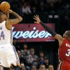 Oklahoma City\'s Daequan Cook puts a shot over Miami\'s Dwyane WadeWade during their NBA basketball game at the OKC Arena in Oklahoma City on Thursday, Jan. 30, 2011. Photo by John Clanton, The Oklahoman