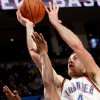 Oklahoma City\'s Nick Collison puts up a shot over Philadelphia\'s Willie Green during the second half of their NBA basketball game at the Ford Center in Oklahoma City on Tuesday, Dec. 2, 2009. The Thunder beat the 76ers 117 to 106. By John Clanton, The Oklahoman