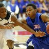 Millwood\'s Chris Cook, at right, tries to get past Hugo\'s Trey Johnson during a Class 3A boys state basketball tournament game between Hugo and Millwood at Yukon High School in Yukon, Okla., Thursday, March 7, 2013. Photo by Bryan Terry, The Oklahoman