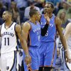 Oklahoma City\'s Kevin Durant (35) celebrates with Russell Westbrook (0) between Memphis\' Courtney Lee (5), Mike Conley (11), and Marc Gasol (33) during Game 6 in the first round of the NBA playoffs between the Oklahoma City Thunder and the Memphis Grizzlies at FedExForum in Memphis, Tenn., Thursday, May 1, 2014. Oklahoma City won 104-84. Photo by Bryan Terry, The Oklahoman