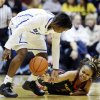 Duke\'s Alexis Jones, left, and Maryland\'s Sequoia Austin chase the ball during the first half of an NCAA college basketball game in Durham, N.C., Monday, Feb. 11, 2013. (AP Photo/Gerry Broome)