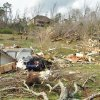 Houses on Short Tail Springs Road are damaged by a tornado that passed through, Friday, March 2, 2012 in Harrison, Tenn. Powerful storms stretching from the Gulf Coast to the Great Lakes flattened buildings in several states, wrecked two Indiana towns and bred anxiety across a wide swath of the country in the second powerful tornado outbreak this week. (AP Photo/Chattanooga Times Free Press, Ashlee Culverhouse) ORG XMIT: TNCHA113