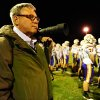 """In this photo taken Friday, Oct. 18, 2013, self-employed photographer Michael Weaver works the sidelines of a high school football game in Jerseyville, Ill. It took him about a week and a half, but Weaver kept going back to the healthcare.gov website until he opened an account and applied for a tax credit that will reduce his health care premiums. Â""""We need to stop the arguing and move forward to make it work,"""" he says. In his mid-50s, with high blood pressure, high cholesterol, but otherwise good health, Weaver said those conditions made it hard for him to get coverage previously. (AP Photo/Michael Thomas)"""