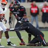 Oklahoma State \'s Tracy Moore (87) gets past Texas Tech\'s Terrance Bullitt (1) and Tre\' Porter (5) during the college football game between the Oklahoma State University Cowboys (OSU) and the Texas Tech University Red Raiders (TTU) at Jones AT&T Stadium in Lubbock, Tex. on Saturday, Nov. 2, 2013. Photo by Chris Landsberger, The Oklahoman