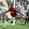 Manchester United\'s captain Patrice Evra, celebrates after scoring his goal against Newcastle United during their English Premier League soccer match at the Sports Direct Arena, Newcastle, England, Sunday, Oct. 7, 2012. (AP Photo/Scott Heppell)