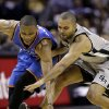 Oklahoma Thunder\'s Russell Westbrook, left, and San Antonio Spurs\' Tony Parker, right, of France, chase a loose ball during the third quarter of an NBA basketball game, Thursday, Nov. 1, 2012, in San Antonio. (AP Photo/Eric Gay) ORG XMIT: TXEG112