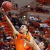 OKLAHOMA PANHANDLE STATE UNIVERSITY: OSU\'s Cezar Guerrero (1) takes a shot past Michael Wiebe (33) of Panhandle State during an exhibition men\'s NCAA college basketball game between the Oklahoma State University Cowboys and the Panhandle State Aggies at Gallagher-Iba Arena in Stillwater, Okla., Wednesday, Nov. 2, 2011. Photo by Nate Billings, The Oklahoman ORG XMIT: KOD