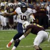 Photo - Syracuse quarterback Terrel Hunt (10) rushes for a gain as Minnesota defensive back Cedric Thompson (2) defends during the second quarter of the Texas Bowl NCAA college football game on Friday, Dec. 27, 2013, in Houston. (AP Photo/David J. Phillip)