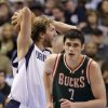 Dallas Mavericks\' Dirk Nowitzki grabs a rebound as Milwaukee Bucks\' Ersan Ilyasova runs up the court during the second half of an NBA basketball game Tuesday, Feb. 26, 2013, in Dallas. Nowitzki had 21 points and 20 rebounds, but Milwaukee won 95-90. (AP Photo/Tony Gutierrez)