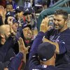 Photo - Atlanta Braves' Dan Uggla, right celebrates with his teammates after he hit a grand slam against the Philadelphia Phillies in the ninth inning of a baseball game Monday, April 14, 2014, in Philadelphia. Atlanta won 9-6.  (AP Photo/H. Rumph Jr)