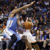 Oklahoma City\'s James Harden (13) tries to get by Denver\'s Andre Iguodala (9) during the NBA preseason basketball game between the Oklahoma City Thunder and the Denver Nuggets at the Chesapeake Energy Arena, Sunday, Oct. 21, 2012. Photo by Sarah Phipps, The Oklahoman