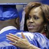 First lady Michelle Obama hugs a student as she hands out diplomas at the Martin Luther King, Jr. Academic Magnet High School graduation on Saturday, May 18, 2013, in Nashville, Tenn. (AP Photo/Mark Humphrey)