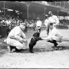 Photo - ADVANCE FOR USE MONDAY, MARCH 31 AND THEREAFTER - This Aug. 25, 1916, photo provided by the Chicago History Museum shows National League's Chicago Cubs baseball player George Pierce petting a bear cub while Cubs player Roger Bresnahan holds the cub's leash at the first National League game at Weeghman Park in Chicago, later to be named Wrigley Field. It is one of the memorable moments in Wrigley Field history as the ballpark approaches it's 100th anniversary. (AP Photo/Courtesy of the Chicago Historical Museum,)
