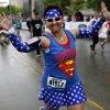 Tammy Pittman of Chickasha begins her run dressed as superman for the 14th Annual Oklahoma City Memorial Marathon in Oklahoma City, Sunday, April 27, 2014. The marathon was delayed over two hours beyond it\'s original start time of 6 a.m. Photo by KT King/The Oklahoman
