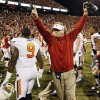 OU defensive coordinator Mike Stoops celebrates next to Oklahoma State\'s Kye Staley (9) after the Bedlam college football game between the University of Oklahoma Sooners (OU) and the Oklahoma State University Cowboys (OSU) at Gaylord Family-Oklahoma Memorial Stadium in Norman, Okla., Saturday, Nov. 24, 2012. OU won, 51-48 in overtime. Photo by Nate Billings , The Oklahoman