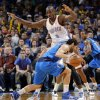 Oklahoma City\'s Serge Ibaka (9) defends on Dallas\' Jose Calderon (8) during the NBA basketball game between the Oklahoma City Thunder and the Dallas Mavericks at Chesapeake Energy Arena in Oklahoma City, Okla. on Wednesday, Nov. 6, 2013. Photo by Chris Landsberger, The Oklahoman