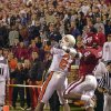 OSU receiver Rashaun Woods goes for a touchdown catch in front of OU\'s Derrick Strait in the fourth quarter of the Bedlam college football game between Oklahoma and Oklahoma State, Saturday Nov. 24, 2001, in Norman, Okla. Woods made the catch to win the game. OSU won, 16-13. Staff photo by Nate Billings.