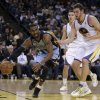 Photo - Memphis Grizzlies' Mike Conley, left, drives the ball past Golden State Warriors' David Lee during the first half of an NBA basketball game Wednesday, Jan. 9, 2013, in Oakland, Calif. (AP Photo/Ben Margot)
