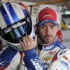 Photo - Jimmie Johnson prepares before practice for Sunday's NASCAR Sprint Cup series Coca-Cola 600 auto race at Charlotte Motor Speedway in Concord, N.C., Thursday, May 22, 2014. (AP Photo/Mike McCarn)