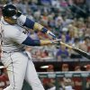 Photo - Detroit Tigers' Miguel Cabrera follows through on a three-run home run against the Arizona Diamondbacks during the eighth inning of a baseball game, Wednesday, July 23, 2014, in Phoenix. (AP Photo/Matt York)