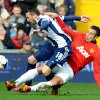 Photo - Manchester United's Robin van Persie   tackles West Brom's Morgan Amalfitano    during the English Premier League soccer match between West Bromwich Albion and Manchester United at The Hawthorns Stadium in West Bromwich, England, Saturday, March 8, 2014.  (AP Photo/Rui Vieira)