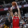 Toronto Raptors forward Andrea Bargnani, of Italy, goes up for a shot over Denver Nuggets forward Kenneth Faried in the first quarter of an NBA basketball game in Denver on Monday, Dec. 3, 2012. (AP Photo/David Zalubowski)