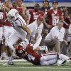 Texas A&M\'s Mike Evans (13) pushes off of Oklahoma\'s Aaron Colvin (14) during the college football Cotton Bowl game between the University of Oklahoma Sooners (OU) and Texas A&M University Aggies (TXAM) at Cowboy\'s Stadium on Friday Jan. 4, 2013, in Arlington, Tx. Photo by Chris Landsberger, The Oklahoman