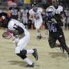 East Central\'s Trent Williams (17) is chased by Guthrie\'s Vincent Norris (34) during a high school football game between Guthrie and East Central at The Rock in Guthrie, Friday, Nov. 18, 2011. Photo by Garett Fisbeck, The Oklahoman