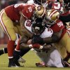 Photo - Atlanta Falcons running back Steven Jackson (39) is tackled by San Francisco 49ers' Ahmad Brooks (55) and Glenn Dorsey during the first half of an NFL football game in San Francisco, Monday, Dec. 23, 2013. (AP Photo/Tony Avelar)