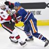 Photo - Ottawa Senators' Bobby Ryan (6) is checked by Edmonton Oilers' Mark Fraser (5) during the second period of an NHL hockey game, Tuesday, March 4, 2014 in Edmonton, Alberta. (AP Photo/The Canadian Press, Jason Franson)