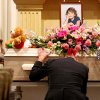 J.J. Johnson kneels in front of his daughter Aja Johnson\'s casket during her funeral at Vondel L. Smith and Son\'s South Colonial Chapel in Oklahoma City on Wednesday, April 7, 2010. Photo by John Clanton, The Oklahoman ORG XMIT: KOD