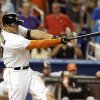 Photo - Miami Marlins' Giancarlo Stanton hits a grand slam to defeat the Seattle Mariners 8-4 during the ninth inning of an interleague baseball game on Friday, April 18, 2014, in Miami. (AP Photo/Lynne Sladky)