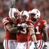 Nebraska\'s Matt O\'Hanlon (33), Phillip Dillard (52) and Prince Amukamara (21) celebrate after O\'Hanlon\'s interception during the second half of the college football game between the University of Oklahoma Sooners (OU) and the University of Nebraska Cornhuskers (NU) on Saturday, Nov. 7, 2009, in Lincoln, Neb. Photo by Chris Landsberger, The Oklahoman