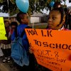 Janesha Roberson holds a sign as she and other students of Western Village Academy prepare to participate in the International Walk to School Day on Wednesday, Oct. 8, 2008, in Oklahoma City, Okla. CHRIS LANDSBERGER, THE OKLAHOMAN