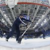 Photo - Volunteers refresh the ice during  a break in the action in the game between Switzerland and Finland during the 2014 Winter Olympics women's ice hockey game at Shayba Arena, Wednesday, Feb. 12, 2014, in Sochi, Russia. (AP Photo/Matt Slocum, Pool)