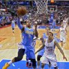 Photo - Denver Nuggets guard Randy Foye shoots as Los Angeles Clippers forward Matt Barnes defends during the first half of an NBA basketball game, Tuesday, April 15, 2014, in Los Angeles.  (AP Photo/Mark J. Terrill)
